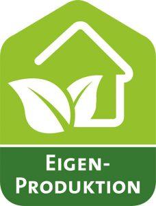 """Grünes Logo der Kampagne """"Eigenproduktion"""". Darauf sind in Weiß die Umrisse eines Hauses und zweier Blätter eingezeichnet."""