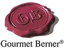 Logo des Feinkostunternehmens Gourmet Berner: ein dunkelrotes Wachssiegel mit den Initialen GB.